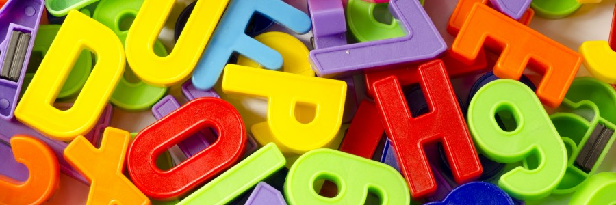 A stacked pile of colored letters and numbers